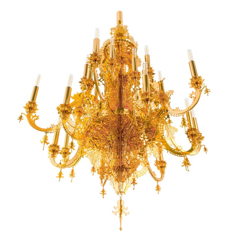 This contemporary chandelier is made in metallic lace and plated gold 24-karat, it is a very decorative hanging light with 12 branches for 24-light bulbs. The chandelier was designed by Enzo Scibetta, using pencil, fretsaw, gimlet, clamps, glue,