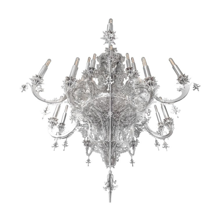 This contemporary chandelier is made in metallic lace and is a very decorative hanging light with 12 branches for 24-light bulbs. The chandelier was designed by Enzo Scibetta, using pencil, fretsaw, gimlet, clamps, glue, carpentry knives, passion