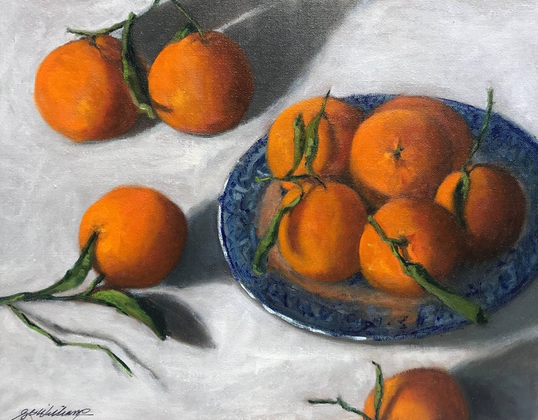 'Blue Willow' is a small representational oil on linen panel still-life painting created by American artist Ginny Williams in 2018. Featuring an exquisite palette mostly made of orange and blue colors, this petite horizontal format oil on linen