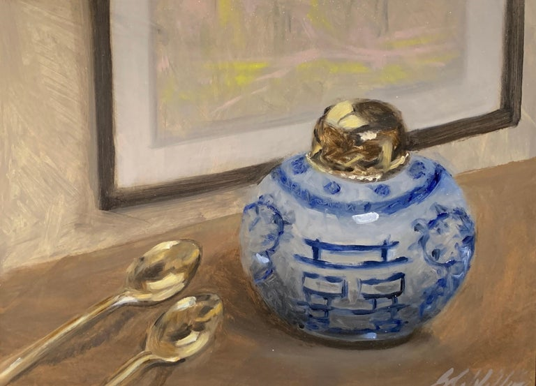 'Still Life With Blue and White' is a small framed representational oil on linen panel still life painting created by American artist Ginny Williams in 2020. Featuring a palette made of blue, neutrals and white, accented by black and brown colors,