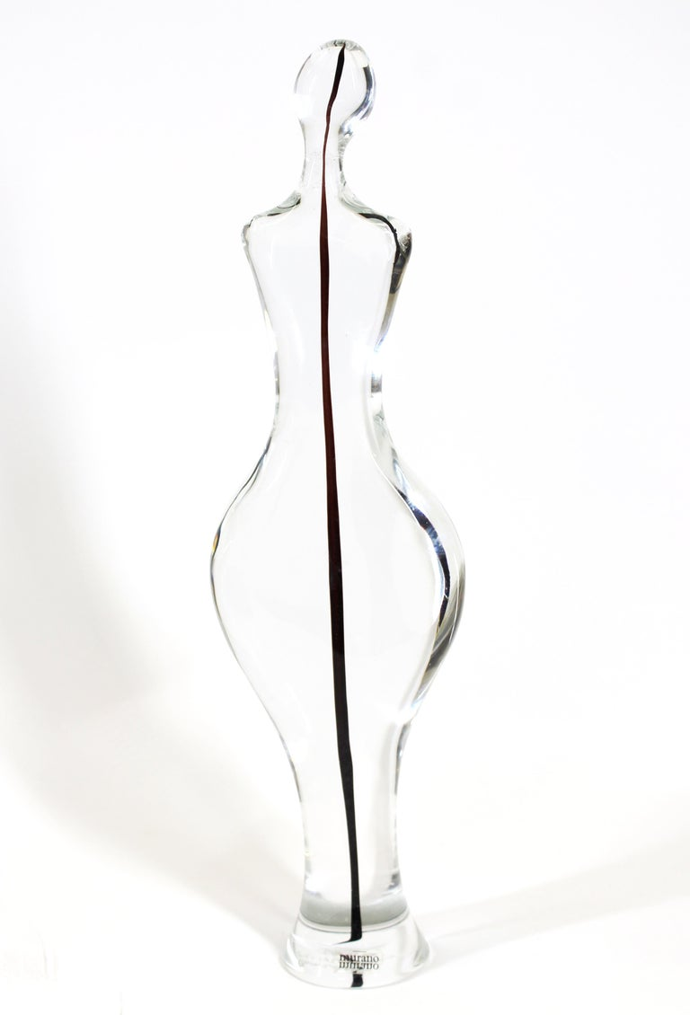 Gino fort for Cenedese Italian modern Murano glass sculpture in shape of a female Silhouette in clear glass with a color stream in the center. Incised 'Cenedese Murano 1982' on the bottom.