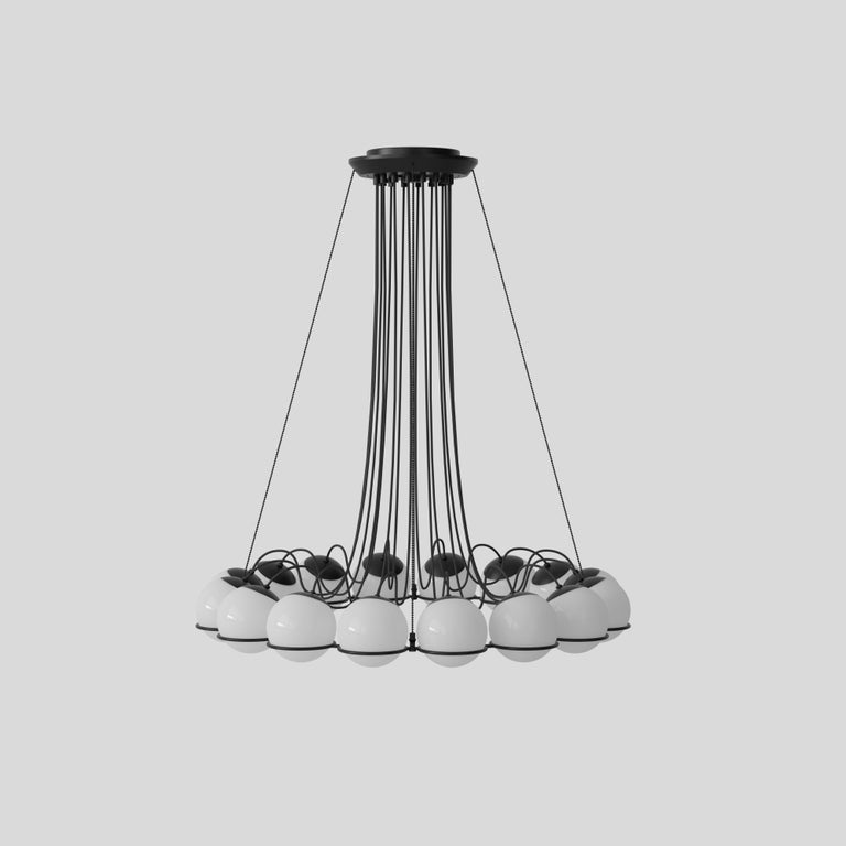 Model 2109 Design by Gino Sarfatti The Le Sfere chandelier is composed of a circular array of blown opaline glass spheres. Each sphere is held in place by a large black or Champagne painted aluminum ring-structure. Each ring has a small cut,