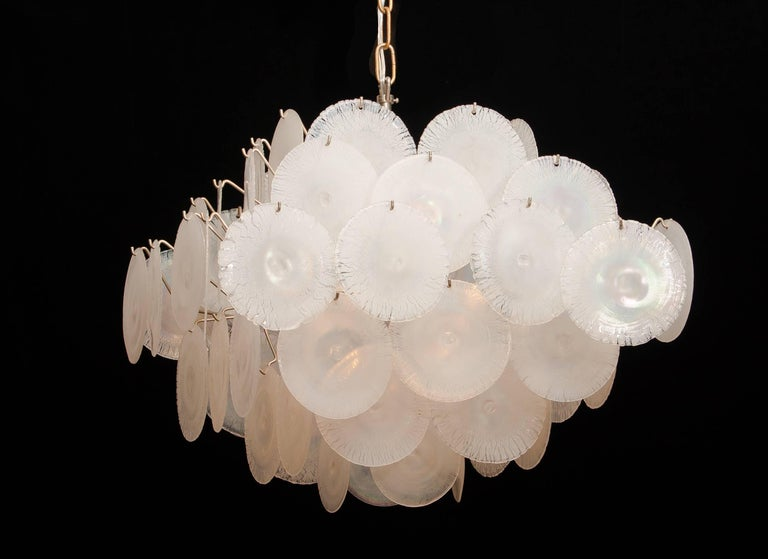 Extremely beautiful Gino Vistosi chandelier with white / pearl colored handmade Murano crystal discs. 