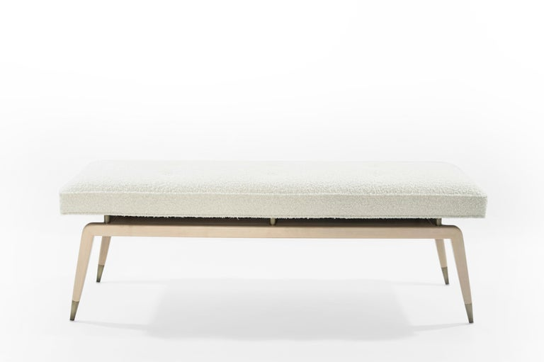 Elevate your space with airy innovation. The Gio Bench is inspired by Gio Ponti – a visionary leader in Italian design. This floating cushion perches on top of solid brass pillars and hangs over a narrow frame. Fluffy bouclé fabric contrasts the
