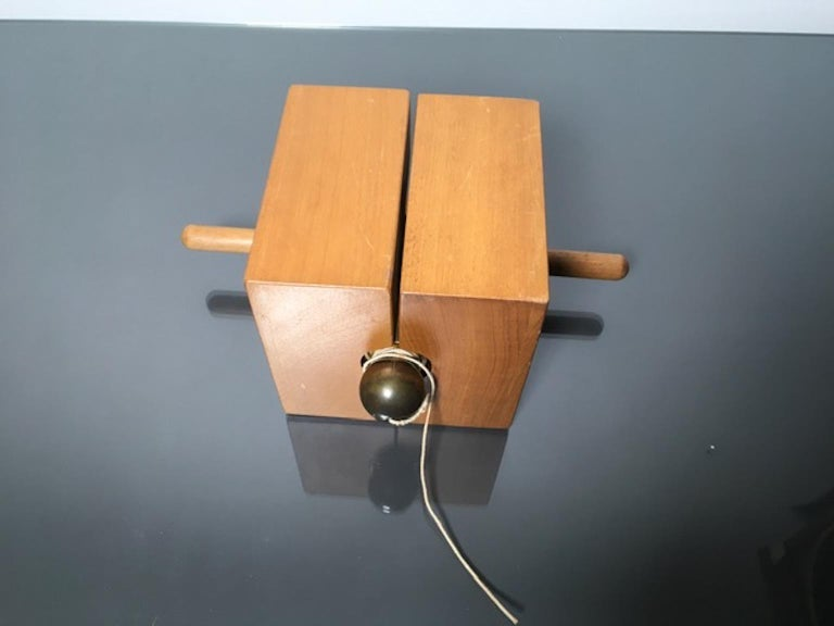 Plumb line sculpture in brass and wood produced in 1970. Numbered and signed Giò Pomodoro. Produced for the company Torno S.P.A.