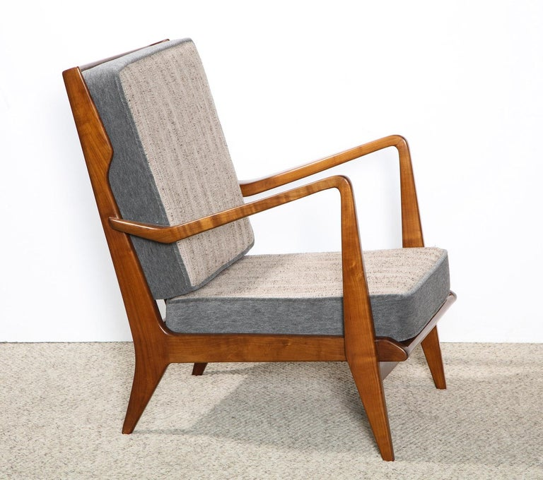 Rare pair of open armchairs by Gio Ponti for Cassina. Sculptural low arm chairs, model #516. Walnut frame and 2-toned upholstered seat back cushions. Manufactured in Italy by Cassina.