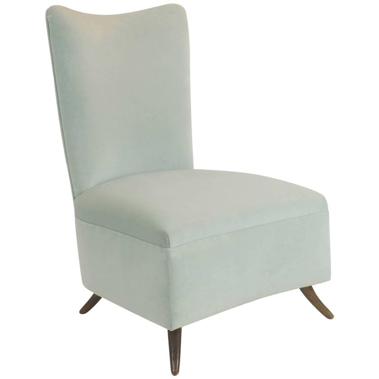 Charming and comfortable armchair. Velvet upholstery in elegant light Verde Acqua color, rounded brass feet. Reupholstered with Italian pure cotton velvet, soft and strong.