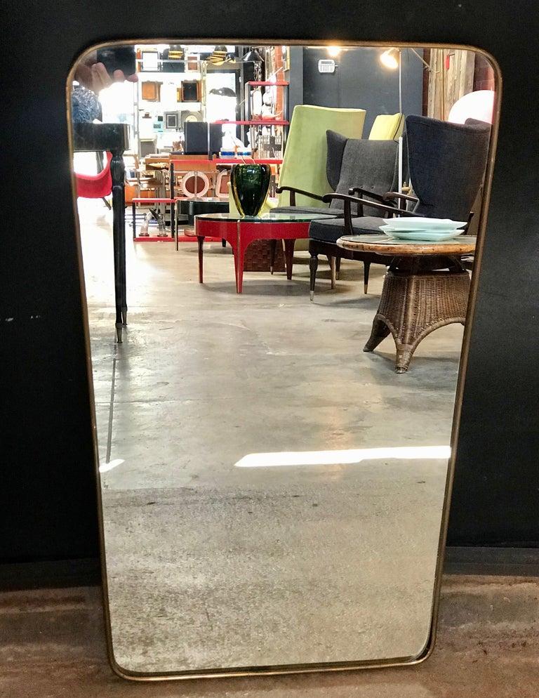 Gio Ponti attributed minimal brass mirror, Italy, 1950s.