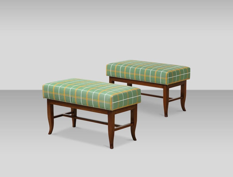 Pair of upholstered benches by Gio Ponti. Rectangular benches with walnut bases and curled lower portion of tapering legs. Very good condition. Wood has been recently cleaned and polish but was most likely refinished at some point. Cushion have