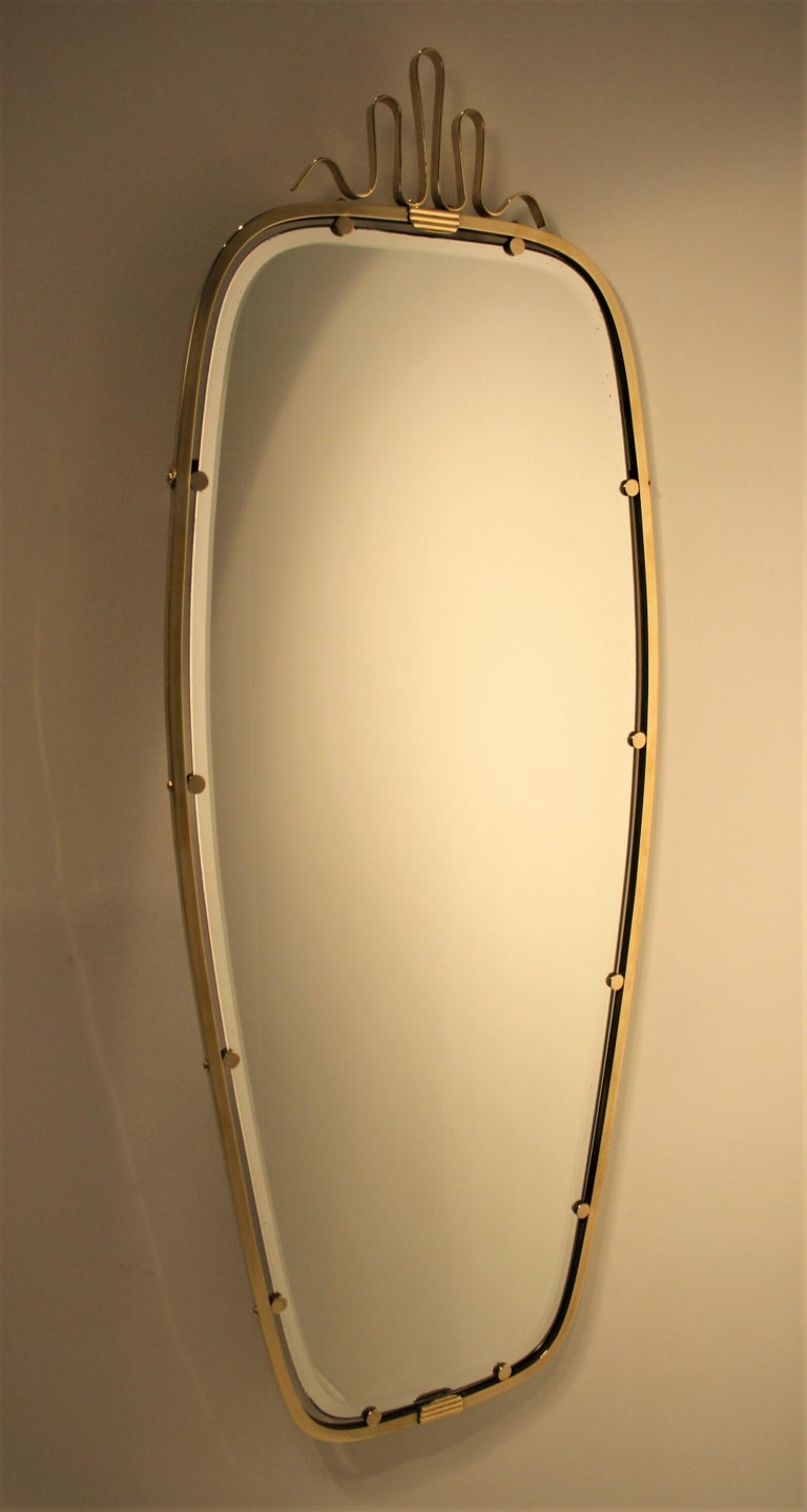 Very refined brass mirror by Gio Ponti for Fontana Arte. Remaining old label of Fontana Arte on the back of the mirror The mirror still has its original beveled mirror in perfect condition, made in the early 1930s and cannot be compared to similar
