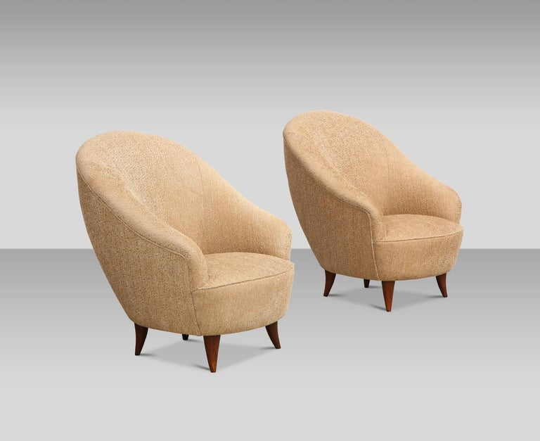 Rare pair of chairs by Gio Ponti. Petite pair of chairs by Ponti. Horn-shaped wood legs and recently upholstery seat and back. Very good restored condition. These chairs have been authenticated by the Gio Ponti Archives.
