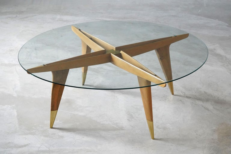 An iconic and rare coffee / cocktail table. Designed by Gio Ponti in his signature style. Production of studio-level quality carried out in the 1950s by M. Singer & Sons, New York, America.   Other designers of the period include Ico Parisi, Jean