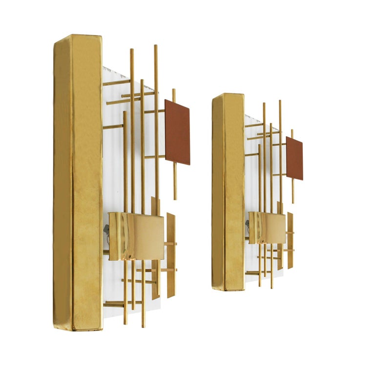 Pair of original model 575 sconces designed by Gio Ponti and edited by Lumi. Lacquered steel structure with brass detailing and Lumi stamp in the back. Italy, 1960s.  Our main target is customer satisfaction, so we include in the price for this item