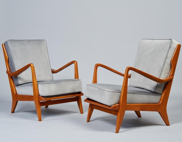 Gio Ponti (1891 - 1979).  A rare and masterful pair of sculptural armchairs by Gio Ponti for Cassina, with sinuously carved arms, architectural tapering back spindles, a gently curved headrest, and subtly modeled and tapered legs. In polished walnut