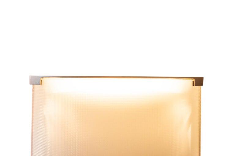 Gio Ponti (1891-1979),  Floor lamp,  Model Pirellone, Edition Fontana Arte,  Glass and brass, Italy, circa 1968.  Measures: Height 184 cm, width 38 cm, depth 17 cm.