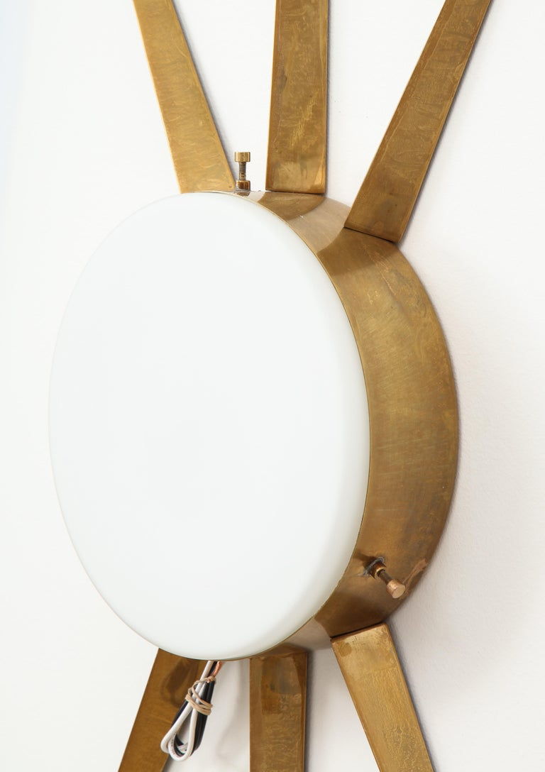 Gio Ponti for Arredoluce rare large pair of sconces or ceiling lights with radiating brass structures and frosted glass shades.  This model was recently confirmed to have been a Gio Ponti design through Gio Ponti archives by Wright auction house