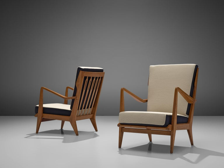 Gio Ponti for Cassina, pair of armchairs model 516, wood, grey upholstered fabric, Cassina, Italy, 1955.  This set of chairs is designed by Gio Ponti and manufactured by Cassina. The chairs have a few distinct features that stand out. For instance