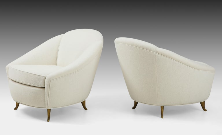 Designed by Gio Ponti in 1936 and manufactured by ISA Bergamo in the 1950s, pair of upholstered armchairs or lounge chairs with elegantly curved back and signature brass legs. These classic and exquisite armchairs have been fully restored and newly