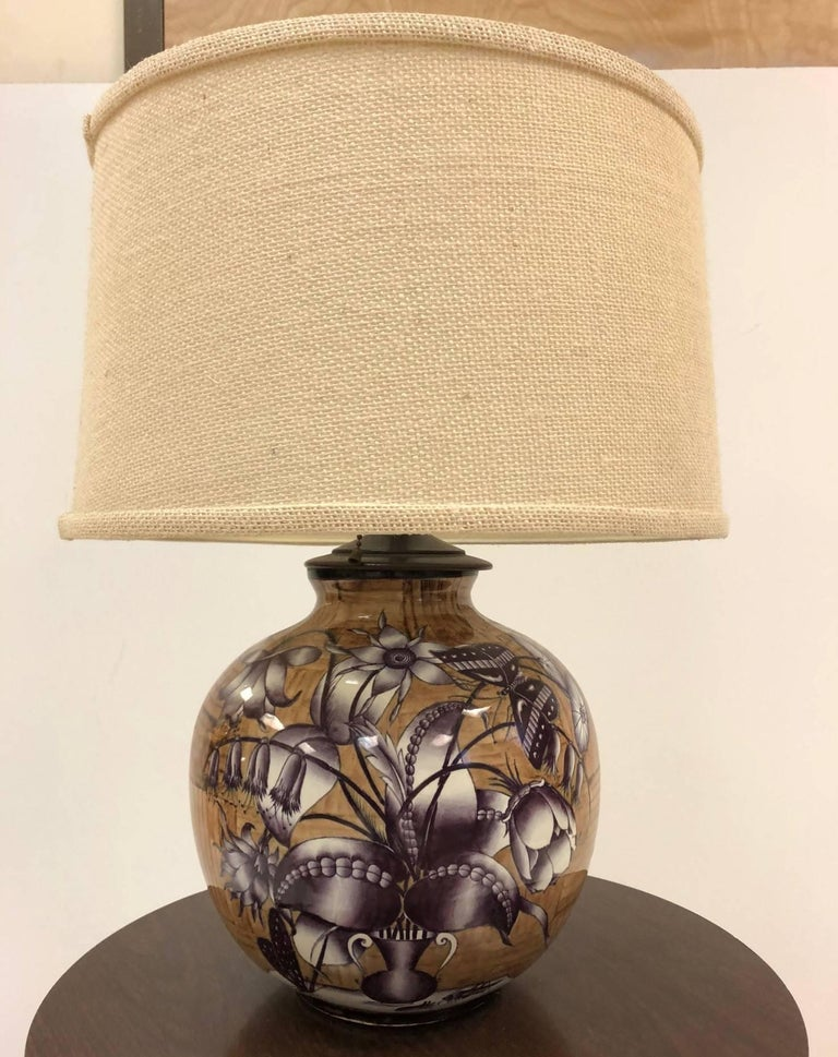 1950s, Gio Ponti for Richard Ginori ceramic lamp. The lamp is spherical and made of enameled painted with floral pattern to one side. The other side is of a bamboo pattern.