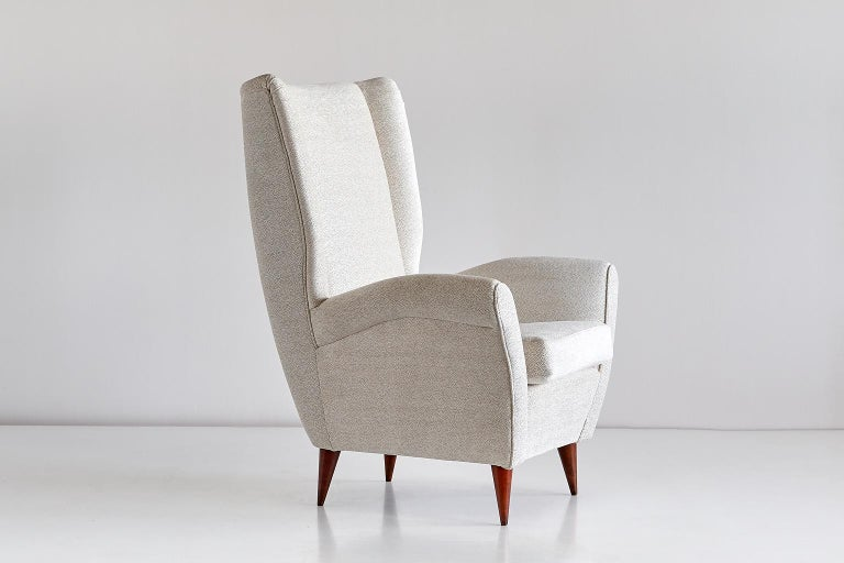 This high back armchair was designed by Gio Ponti for a private commission in the late 1940s. The chair is characterized by its strikingly modern lines, elegantly tapered walnut legs and generous proportions.  The comfortable armchair has been