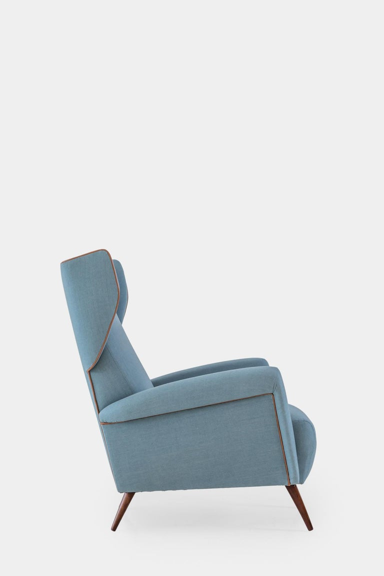 Designed by Gio Ponti for the Hotel Royal Naples and manufactured by both Cassina and Dassi, this armchair has the classic shape of a wingback chair but with the modernist lines and playful expression exemplary of Pont's work. Fully restored and