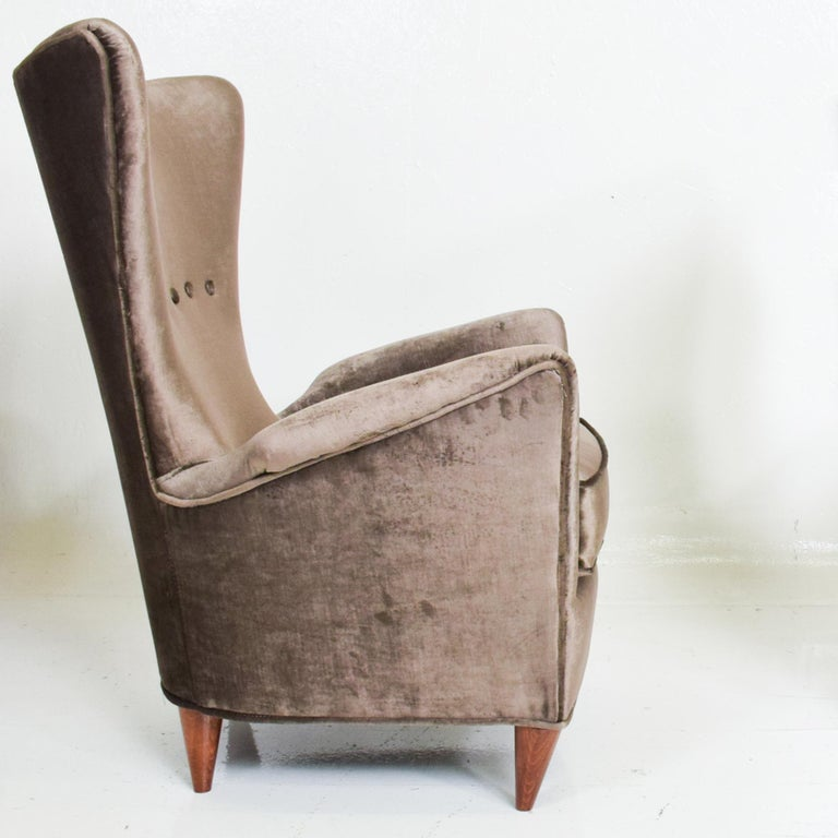 For your consideration: Luxurious pair of armchairs Italian Art Deco design by Gio Ponti for Hotel Bristol Merano Italy. Low slung arm lounge chairs with sculptural shape. Made in Italy early 1950s Dimensions: 36.5 H x 30 D x 26 .5 W Seat 16 H