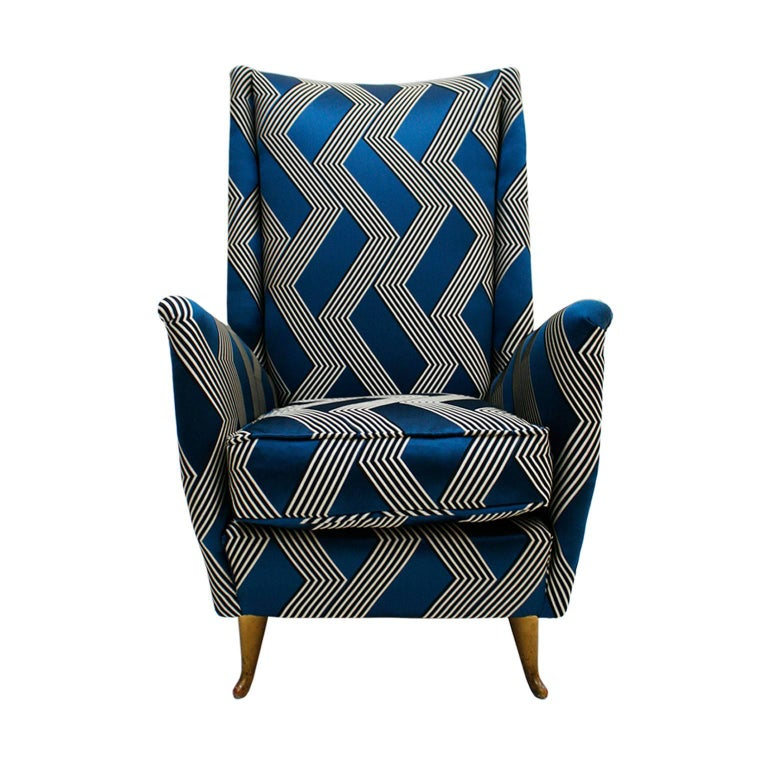 Pair of armchairs designed by Gio Ponti. Made of original solid wood structure, reupholstered in a bicoloured geometrical pattern that stands out in relief on a compact satin ground with a silky hand, The effect is that of an embroidery of two bulky