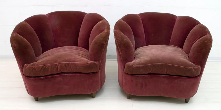 Rare sofa and two armchairs by Gio Ponti for Casa e Giardino, 1936. Shell model covered in original velvet of the time, with goose down cushions. The coating, as shown in the photo, has faded in some parts and worn out. It is recommended to redo