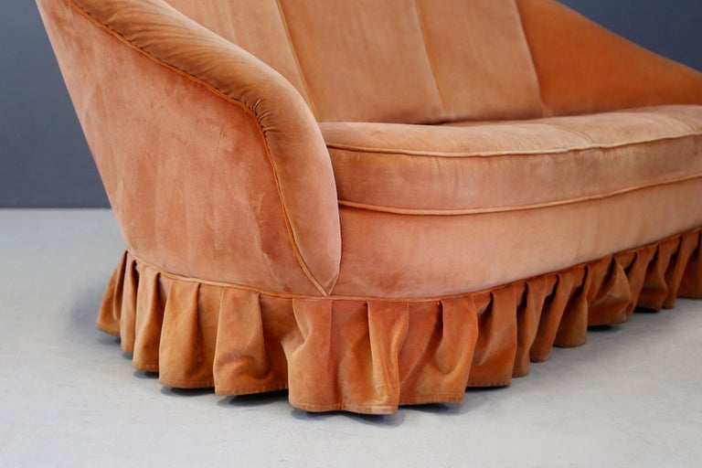 Elegant 1930s two-seater sofa designed by designer Gio Ponti. Warning: The sofa is in its original state, its upholstery is also original of the period in orange velvet. The fabric has defects and lacks. Note its very soft and enveloping line. At