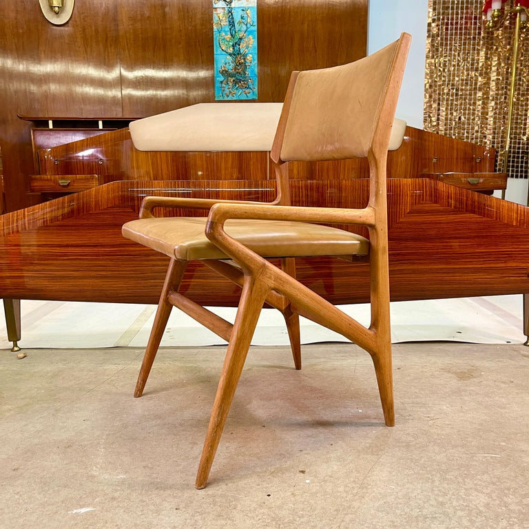 Gio Ponti designed chair model 688 produced by Cassina in 1952 for M. Singer & Son's, New York. This is the armchair companion to the model 687 side chair (see original Cassina photos of both). Original unrestored condition, not refinished.