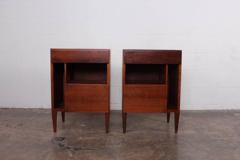A pair of mahogany bedside tables designed by Gio Ponti for Singer & Sons.