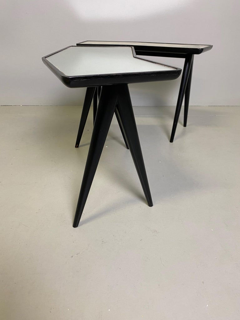 Pair of Italian master architect Gio Ponti black lacquered walnut side tables with mirrored glass tops by Pietro Chiesa.   From the circa 1960s.