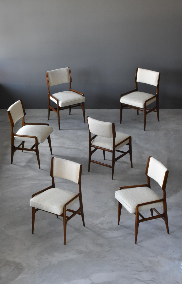 A set of 6 rare and early dining chairs model AP 1676. Designed by Gio Ponti and produced by Figli di Amedeo Cassina, Meda, Italy.   Images of chairs pre-restoration available upon request.