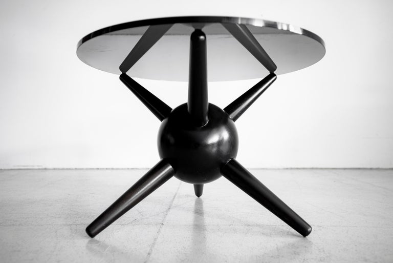 Newly produced side table in the style of Gio Ponti. Beautifully crafted in walnut and refinished in ebony.  Smoked black glass top.