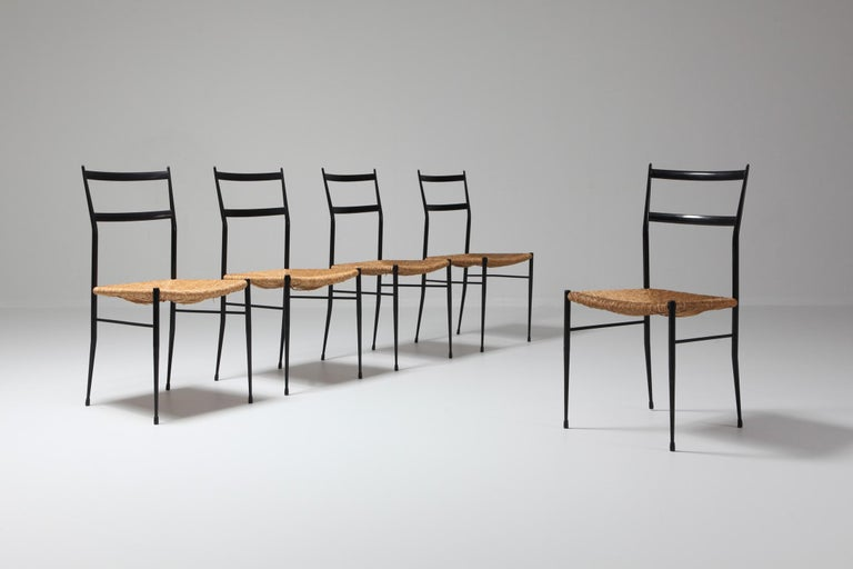 Mid-Century Modern 5 metal superleggera style chairs attributed to Gio Ponti. These chairs where sold in the famous Dutch warehouse ''De Bijenkorf''.  Gio Ponti totally redesigned the Bijenkorf in Eindhoven in 1969.