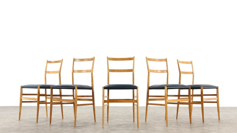 A early authentic set of five Gio Ponti Superleggera leather dining chairs by Cassina, Italy, 1958. This rare beautiful set is in good vintage condition two chairs have been restored please look as seen in the pictures.