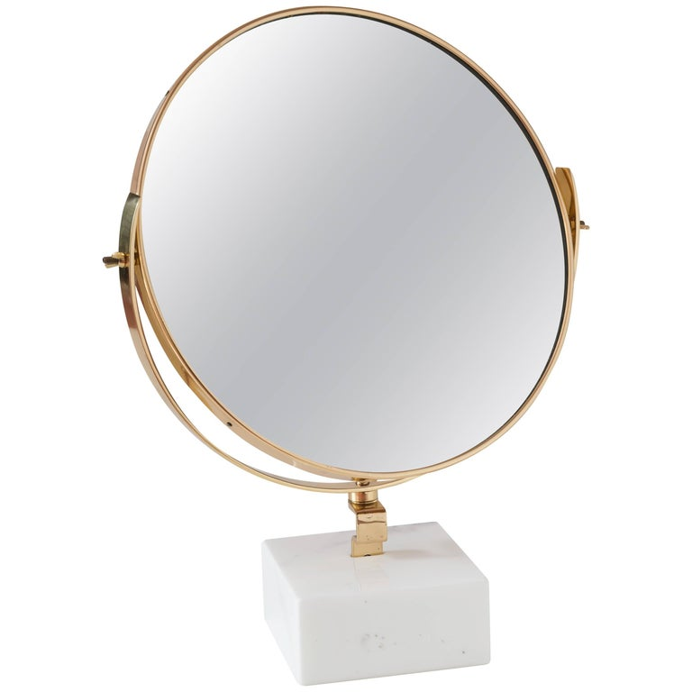 Vanity mirror designed by Gio Ponti for the vanity of Hotel Royal, Napoli, 1955 and produced by Fontana Arte in 1955.  limited editon Original piece customized by CG with marble support in 2016.  The Gio Ponti vanity was produced by Giordano