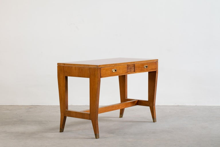 Exquisite executive desk designed by Gio Ponti and produced by Schirolli for Banca Nazionale del Lavoro in the mid-1950s. Walnut desks with Formica tops and brass handles.