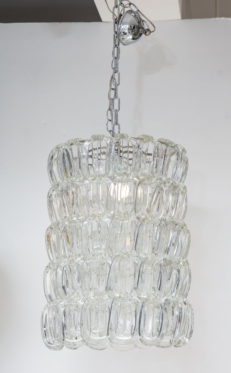 The Giogali chandelier by Angelo Mangiarotti, (1921-2012) for Vistosi, the Murano glass links display as double horseshoe rings, supported by metal interior rings. (Re-wired for USA standards). The glass length, displayed here with 4 levels can be