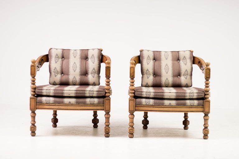 Distinguished Giorgetti armchairs of the 1975 Gallery collection. Rare Classic Italian set of carved wood armchairs with original upholstery. Two available, priced individually. Marked.