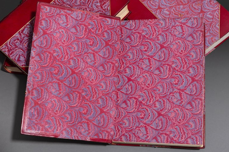 4 Volumes. Giorgia Vasari. Lives of Painters, Sculptors & Architects. Bound in 3/4 Red Morocco, marbled boards, top edges gilt, raised bands, gilt panels. Published: New York: Charles Scribner's Sons 1911.