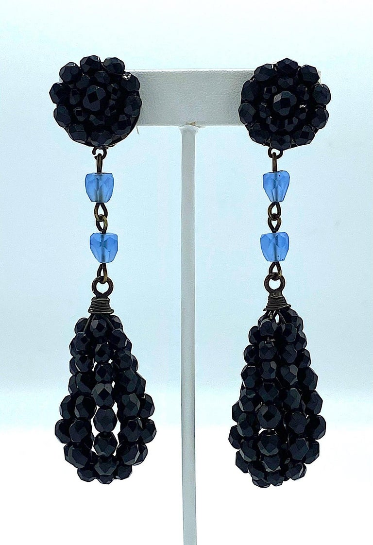 An incredibly elegant pair of Giorgio Armani black crystal bead pedant earrings from the 1980s. The top button is comprised of black crystal beads .88 of an inch in diameter with a clip back. The back of one earrings has a rectangular signature