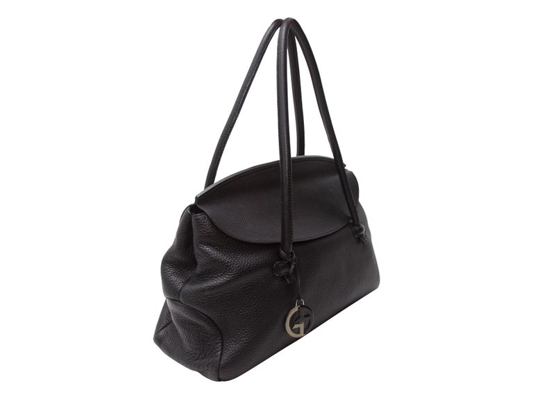 Product details:  Black large pebbled leather tote bag by Giorgio Armani.  Dual shoulder straps.  Front flap.  Lined interior with inner zip and slide pockets.  Silvertone hardware.  20