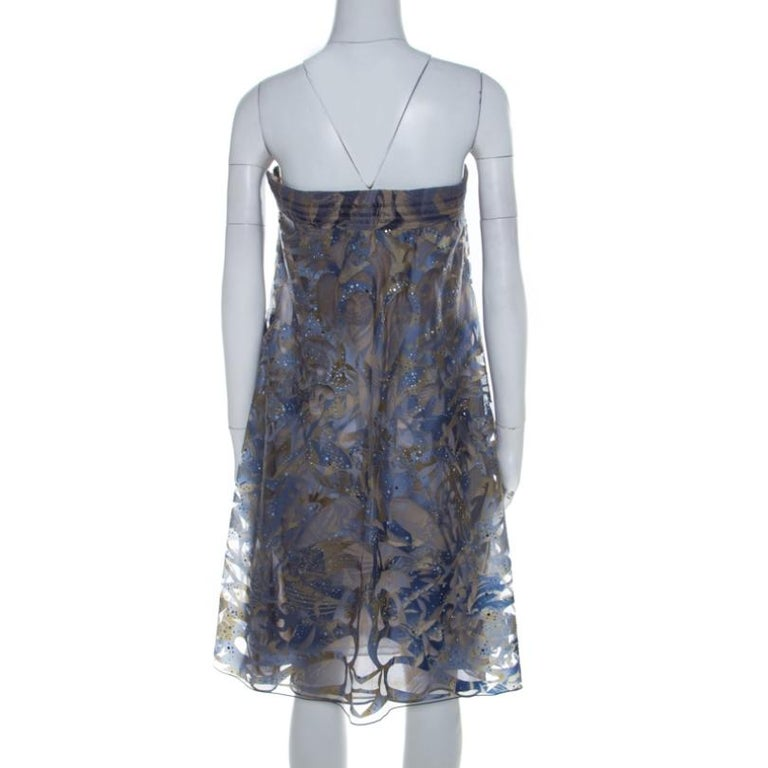 Make a unique fashion statement when you go out wearing this elegant Giorgio Armani dress. This blue number is just perfect for those cocktail parties and red carpet events. Brilliantly made in smooth nylon with crystal embellishments, this attire
