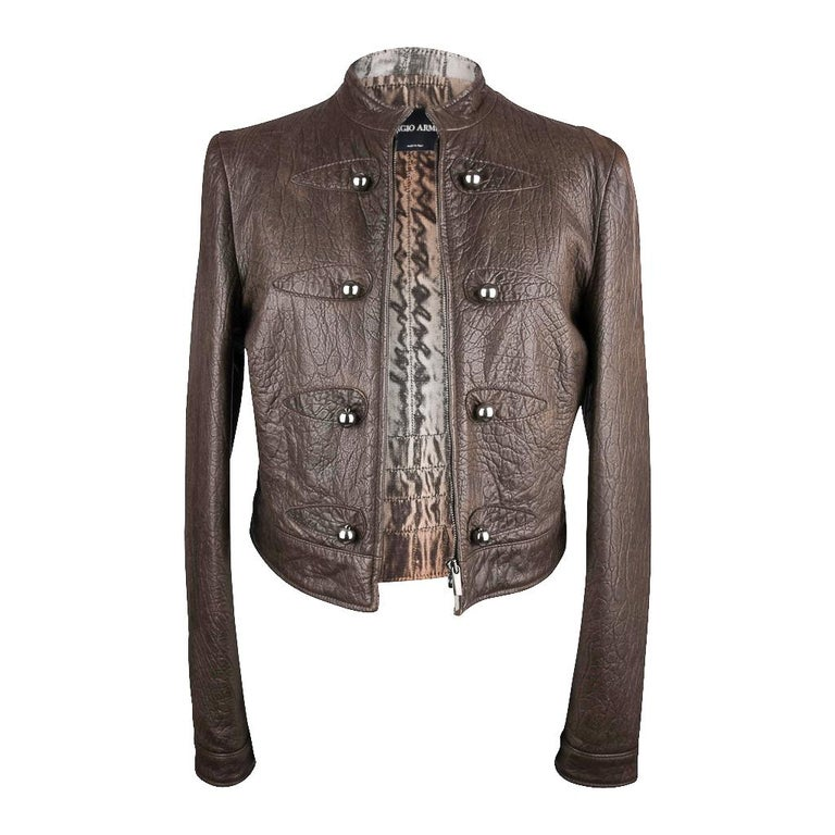 Giorgio Armani softest, most yummy lamb skin leather.   This taupe brown is SO chic and stunning with black.   Fantastic texture. Mandarin collar, zipper closure.  Dark silver round hardware down each side and on the cuffs.  This is the uptown, chic