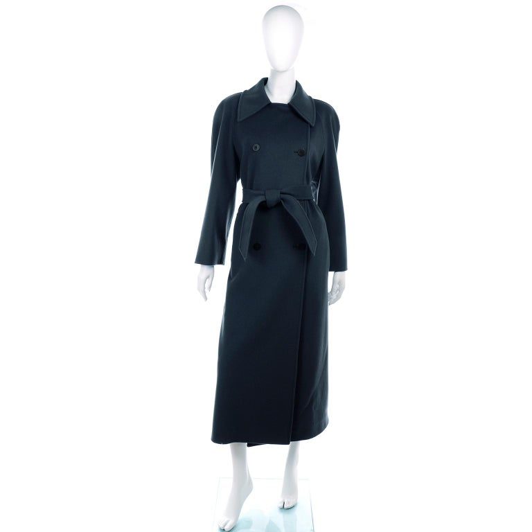 This is a beautiful Giorgio Armani Le Collezioni pure wool double breasted vintage coat with belt. The wool fabric is a deep green/gray and the coat is full lined. Perfect for cold weather, this coat has a wonderful weight to it.   This lovely coat