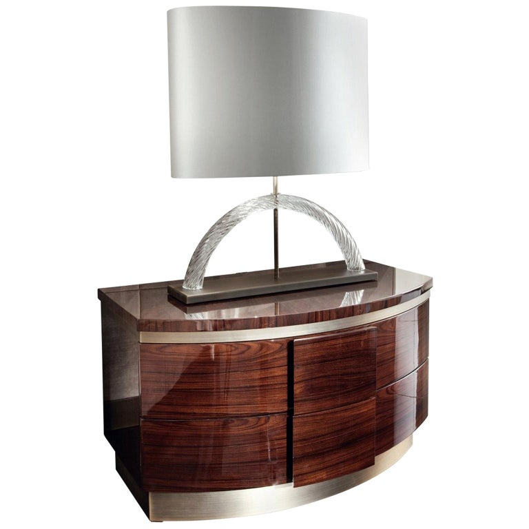 Nightstand sunburst top of Brazilian rosewood veneer, this night table is a striking piece. It is finished in a high gloss veneer and set over a bronzed stainless steel base. This piece features two drawers for ample storage; both are lined in