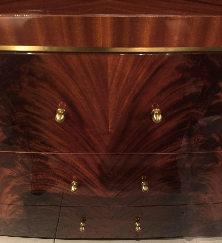 """Giorgio USA - Oval dresser with combination of crotch mahogany and straight sapele mahogany. Three big drawers with brushed brass knobs. Top trim and base trim made of brushed brass.  Size: cm 198W x 54D x 94H  Size: 78""""W x 21""""D x 37""""H  Crotch"""
