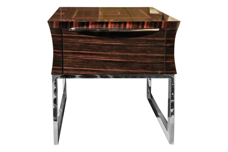 Unique Square wooden end table in makassar ebony veneer in glossy finish.
