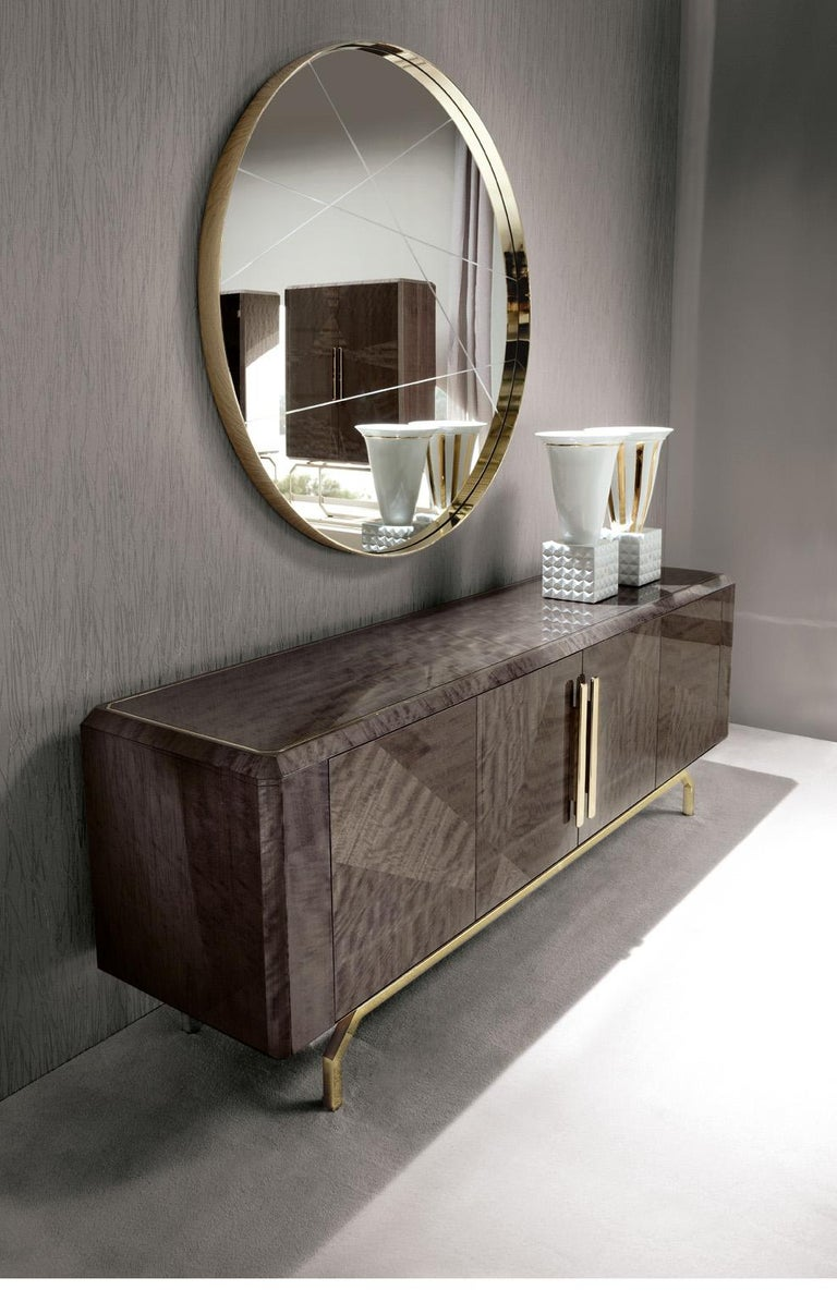 Buffet with 4 inlaid doors in makorè mahogany veneer with high gloss polyester finish. Top with insert in light gold chrome stainless steel. Base and 2 center handles in light gold chrome stainless steel with Giorgio collection logo. 2 lateral